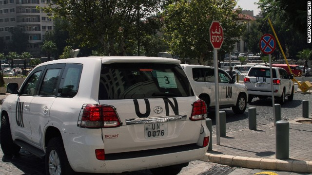 A convoy of United Nations (UN) vehicles leave a hotel in Damascus on August 26, 2013 carrying UN inspectors travelling to the site of a suspected deadly chemical weapon attack the previous week in Ghouta, east of the capital.