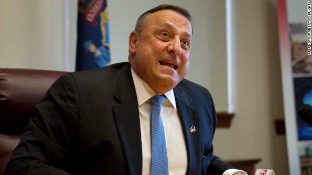 Gov. Paul LePage speaks to reporters after the Maine House and Senate overrode his veto of the state budget on June 26.