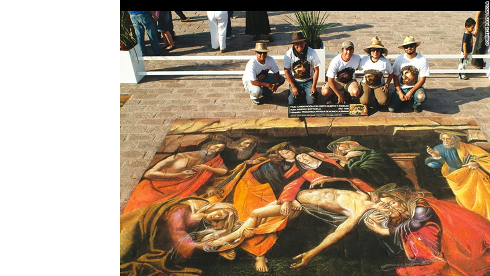 Artists Eduardo Bustos, from left, Alberto Viloria, Jesus Carrizal, Helena Guzman and Cesar Polack pose with their rendition of the Lamenting of the dead Christ in the Macroplaza of Monterrey, Mexico.