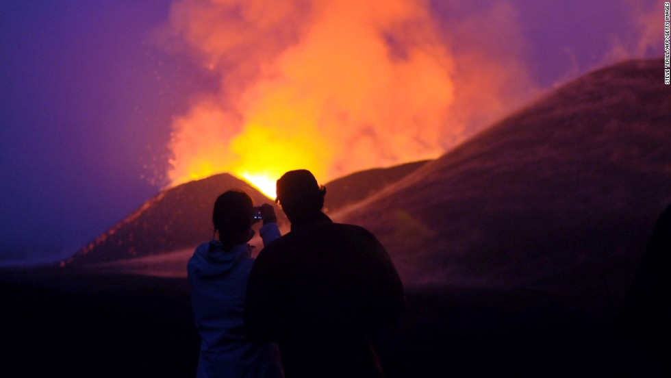 Tampa says Congo has the potential to be a huge tourist attraction, creating jobs and businesses for the region. Tourists take a photo of a volcanic eruption at the Virunga National Park, near Goma.