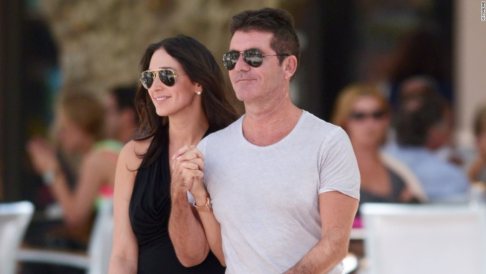 Simon Cowell walks hand-in-hand on August 26.