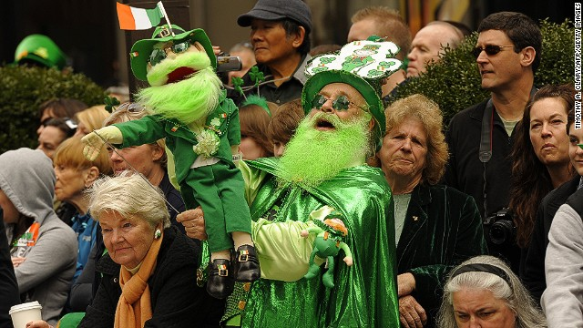 Parade-goers watch the 251st St Patrick's Day Parade up 5th Avenue in New York on March 17, 2012.
