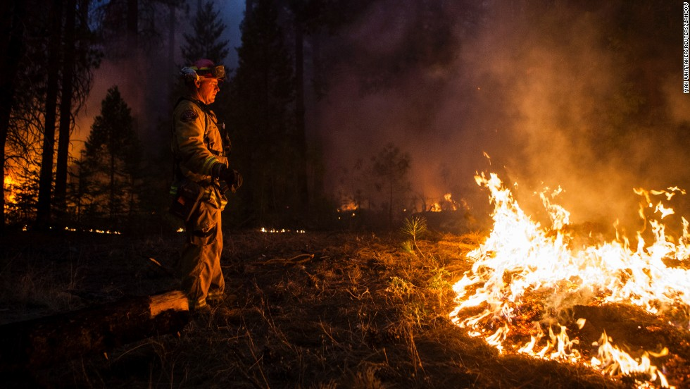Sacramento Metropolitan firefighter John Graf monitors the Rim Fire line near Camp Mather, California, on Monday, August 26.
