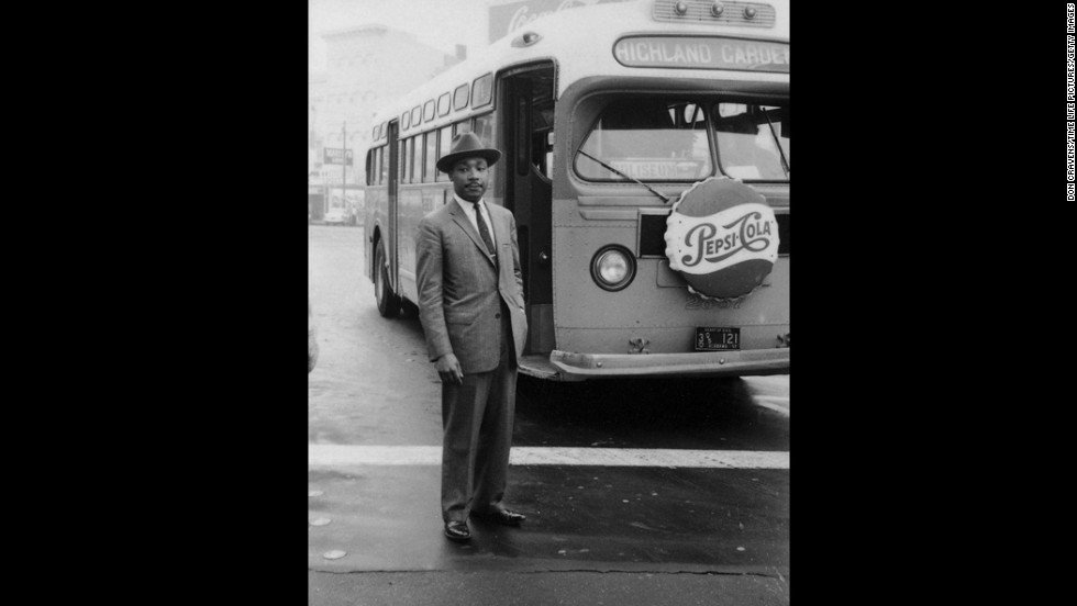 King stands in front of a bus at the end of the Montgomery bus boycott in Montgomery, Alabama, on December 26, 1956.