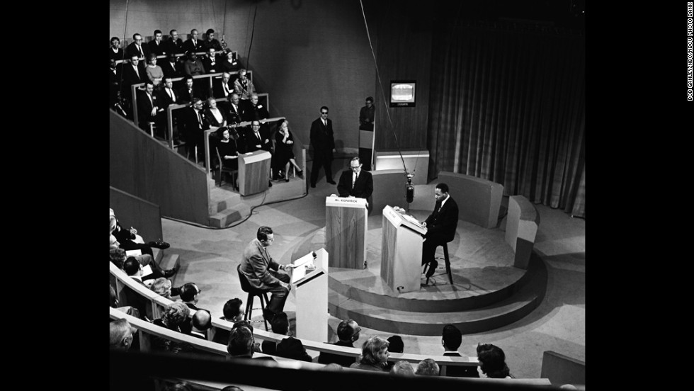 Moderator John McCaffery, left, segregationist editor James J. Kilpatrick and King debate segregation in New York on November 11, 1960.