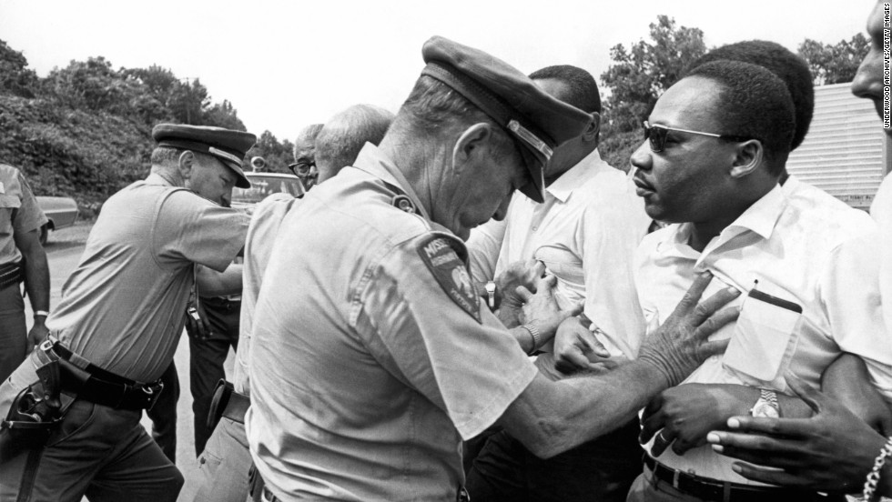 "Mississippi patrolmen shove King during the 220-mile ""March Against Fear"" from Memphis, Tennessee, to Jackson, Mississippi, on June 8, 1966."
