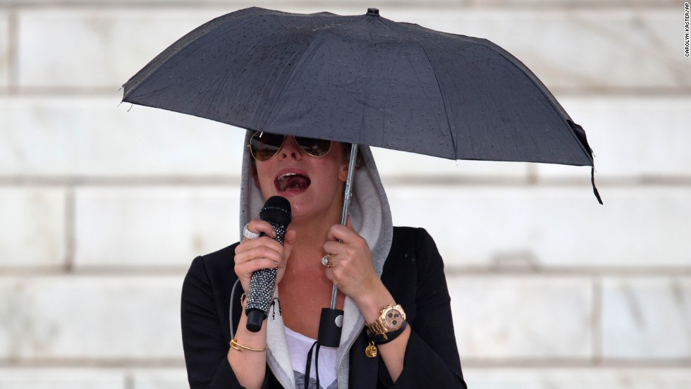 "Country singer LeAnn Rimes sings ""Amazing Grace"" in preparation for her performance during the Let Freedom Ring ceremony, on the steps of the Lincoln Memorial in Washington an August 28."
