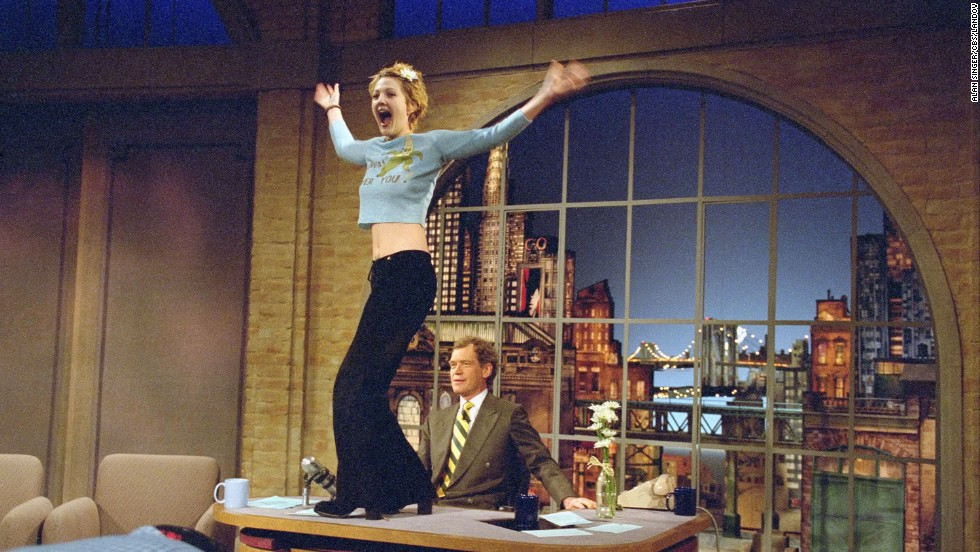 "When Drew Barrymore showed up on ""Letterman"" in 1995, she came bearing gifts -- of a sort. The then-20-year-old actress was a ball of ""good energy,"" and when talk turned to her interest in ""nude performance dance,"" Letterman of course had to get a preview -- complete with flashing. It was his birthday, after all."