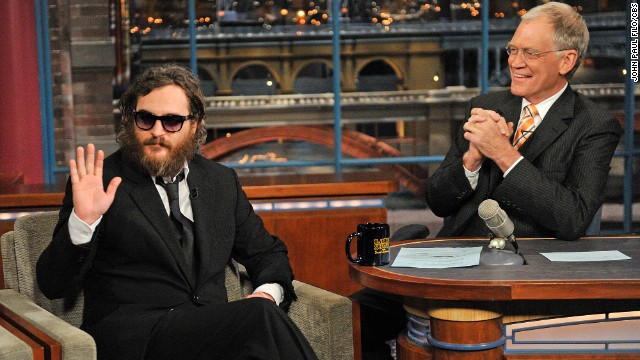 Actor Joaquin Phoenix, waves to the audience during his interview with Late Show host David Letterman during the Late Show with David Letterman Wednesday Feb. 11, 2008 on the CBS Television Network. Photo: John Paul Filo/CBS ©2009 CBS Broadcasting Inc. All Rights Reserved.