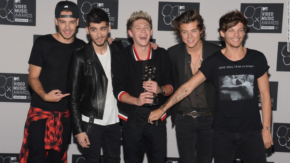 Which One Direction member recently got engaged?