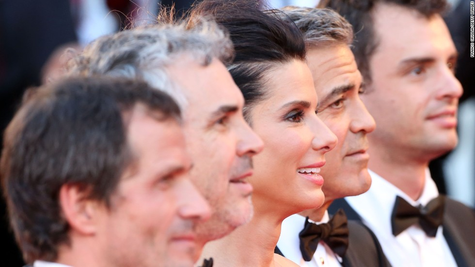 "The cast and crew of ""Gravity,"" from left, producer David Heyman, director Alfonso Cuaron, actress Sandra Bullock, actor George Clooney and screenwriter Jonas Cuaron, celebrate the movie's premiere Wednesday, August 28."