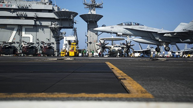 "A picture released by the US Navy shows an F/A-18F Super Hornet assigned to the Swordsmen of Strike Fighter Squadron 32 performing a touch and go on the flight deck of the aircraft carrier USS Harry S. Truman (CVN 75) on August 15, 2013 in the Mediterranean Sea. US forces are ""ready to go"" if called on to strike the Syrian regime, Defense Secretary Chuck Hagel told the BBC on August 27, 2013, saying evidence pointed to its use of chemical weapons. The Pentagon chief said forces had been deployed as needed and President Barack Obama had reviewed military options presented by commanders. AFP PHOTO/US NAVY Lyle H. Wilkie III"