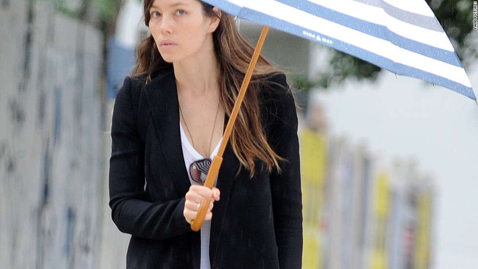 Jessica Biel tries to dodge bad weather in New York City on August 28.