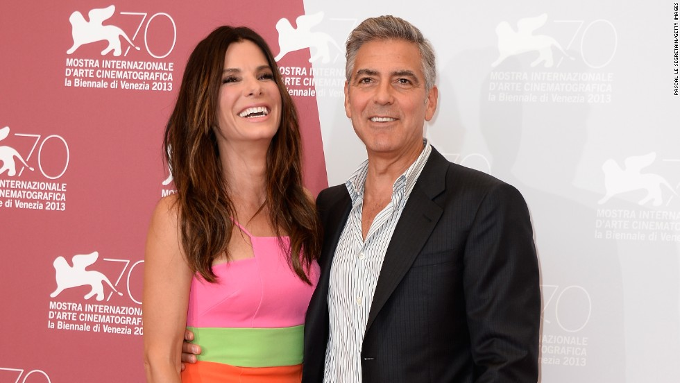 There's nothing to frown about for George Clooney and Sandra Bullock at the Venice International Film Festival on August 28.