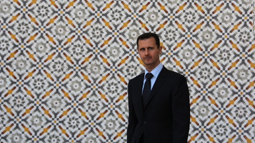 Al-Assad is seen at the Al-Shaab Palace in Damascus on June 24, 2009
