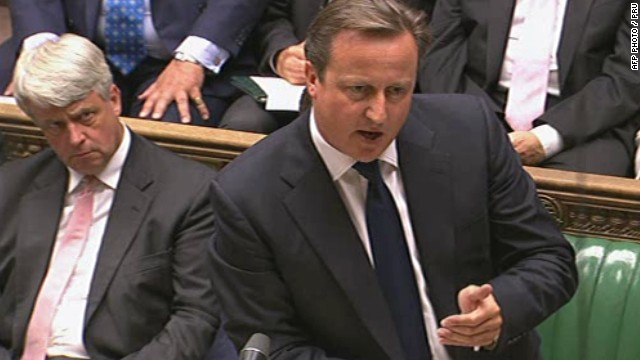 "A video grab from footage broadcast by the UK Parliaments Parliamentary Recording Unit (PRU) via Parliament TV on August 29, 2013 shows British Prime Minister David Cameron (R) speaking at the dispatch box delivering his statement during the debate about a response to the situation in Syria in the Houses of Parliament next to Leader of the British House of Commons Andrew Lansley (L) in central London on August 29, 2013. Lawmakers recalled to parliament vote on august 29 on Britain's response to chemical weapons attacks in Syria -- but approval for military action will require a second vote after the opposition blocked Prime Minister David Cameron's way. RESTRICTED TO EDITORIAL USE - MANDATORY CREDIT "" AFP PHOTO / PRU "" - NO MARKETING NO ADVERTISING CAMPAIGNS - NO RESALE - NO DISTRIBUTION TO THIRD PARTIES - 24 HOURS USE - NO ARCHIVES-/AFP/Getty Images"