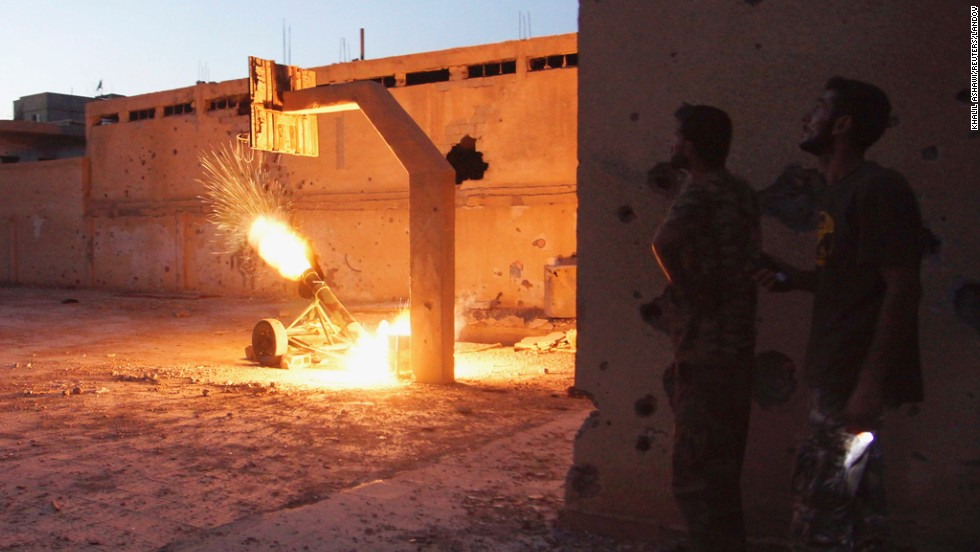 Free Syrian Army fighters launch a rocket toward forces loyal to Syrian President Bashar al-Assad in Deir Ezzor on August 29.