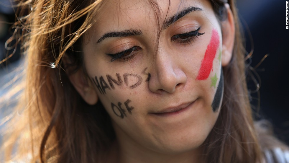 A protester stands outside Downing Street in London on Wednesday, August 28, to campaign against Western military intervention in Syria.