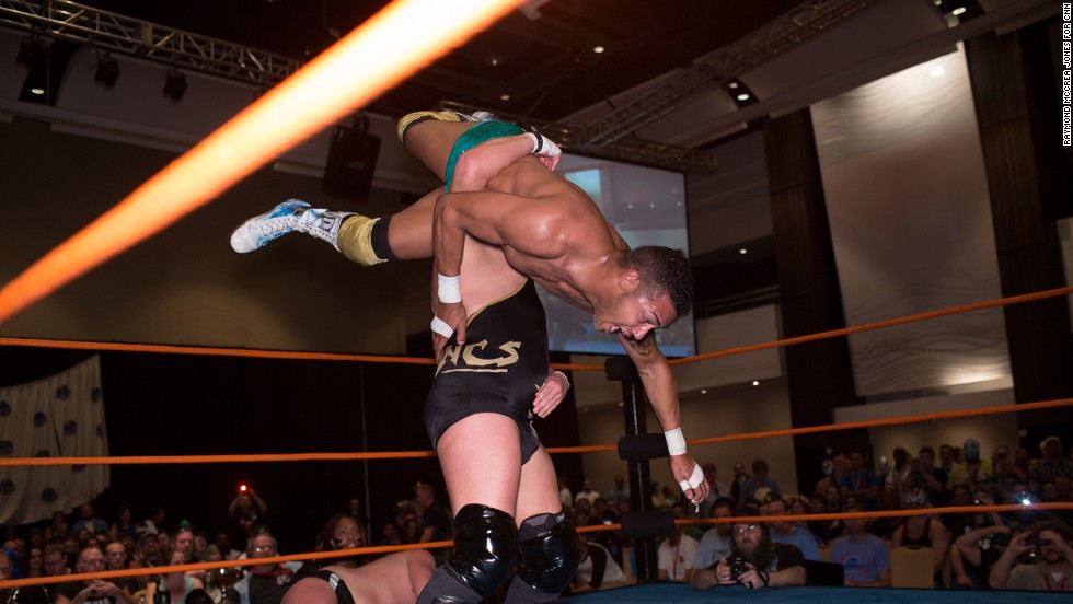 Wrestler Ethan Case body slams C.B. Suavé during one of the convention's most popular events.