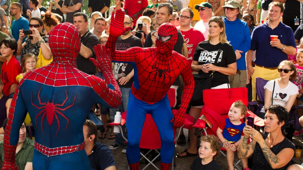 Two people dressed as Spider-Man high-five during the Dragon Con parade in downtown Atlanta on Saturday, August 31. The 27th annual sci-fi and fantasy convention is expected to draw more than 57,000 people.