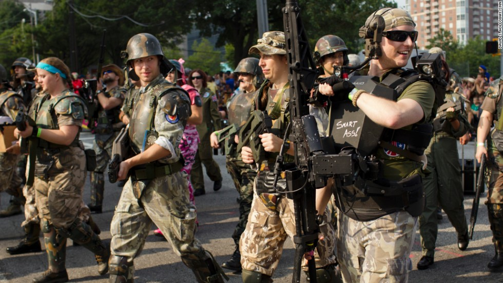 A group of people dressed as soldiers march in the parade.