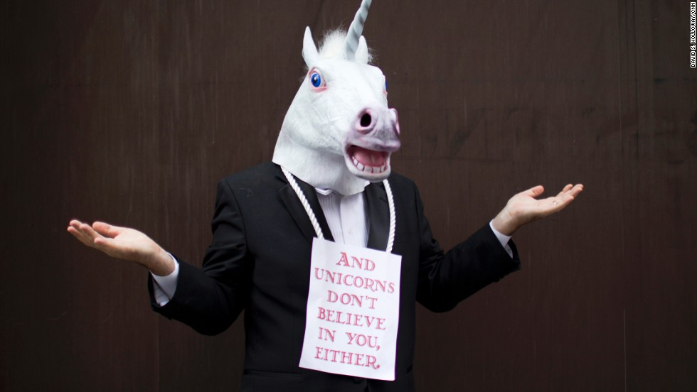 Ted Freeman attends the Dragon Con parade dressed as a unicorn.