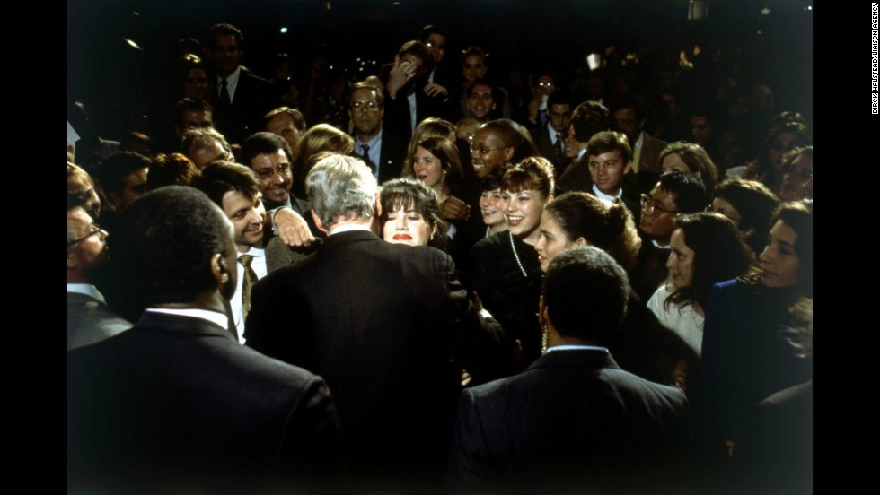 President Bill Clinton hugs Monica Lewinsky at a 1996 fund-raiser in Washington. At the time their relationship wasn't public, so the image fell into obscurity. But when the news of their affair broke, photographer Dirck Halstead recognized Lewinsky and recovered the photo from his archives. It eventually ran on the cover of Time magazine, and the Lewinsky scandal led to Clinton's impeachment.