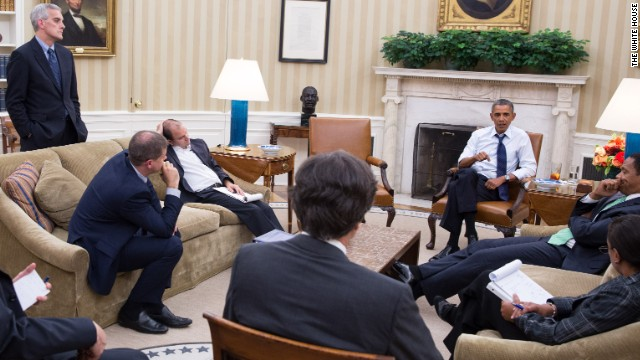 President Barack Obama meets with senior advisors in the Oval Office to discuss a new plan for the situation in Syria, Friday night, August 30, 2013. Credit: