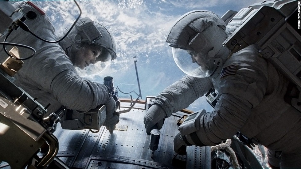 """<strong>""""Gravity"""":</strong> George Clooney and Sandra Bullock star in """"Gravity,"""" the new film from Alfonso Cuaron (""""Children of Men""""), about two astronauts who have to find a way to survive in space after a damaging accident. """"Gravity"""" debuted at the Venice Film Festival and has received glowing reviews. """"Should inspire awe among critics and audiences worldwide,"""" wrote Variety's Justin Chang in a typical rave. (October 4)"""