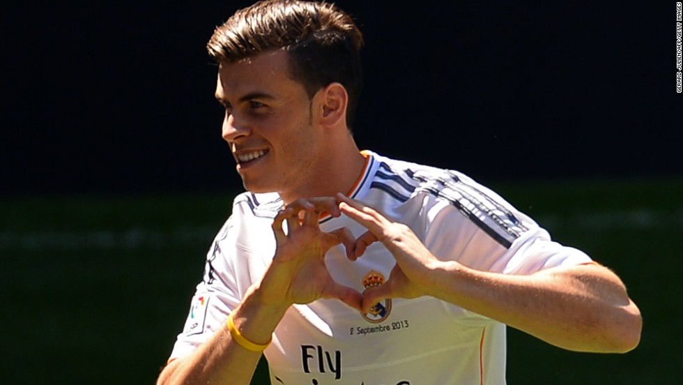 Gareth Bale shows the love for his new club with his recently trademarked heart hand sign.