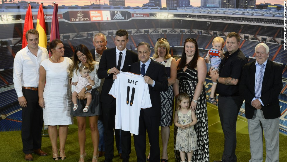 Members of Gareth Bale's family join the Welsh winger following his signing for Real Madrid. Girlfriend Emma Rhys Jones is standing alongside (third left) the playmaker clutching his daughter Alba Violet Jones.