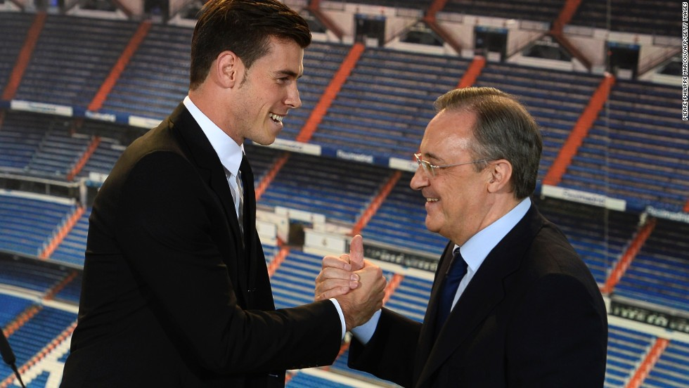 "Florentino Perez (right) said Bale will ""make the legend of the club greater and stronger"" before adding: ""This is your stadium, your shirt, your badge and your fans. From today this is your home."""