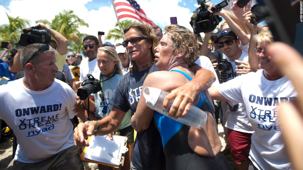 Nyad and her trainer Bonnie Stoll hug as Nyad walks ashore on September 2.