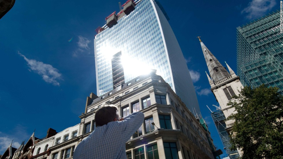 "Intense light beams down from the new ""Walkie Talkie"" tower in central London on Friday, August 30. The curved side of the glass tower reflects such a strong beam of light that it has melted parts of cars."