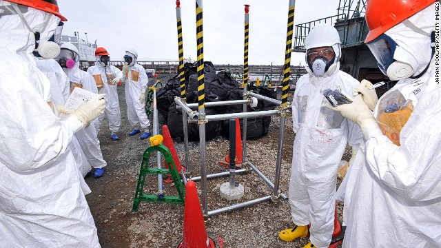 Government officials and nuclear experts inspect a monitoring well where high levels of radioactive materials were detected at the Fukushima Dai-ichi nuclear plant.