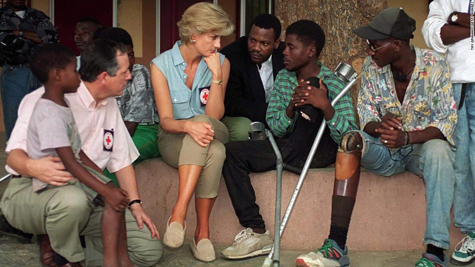 Princess Diana speaks with amputees who were victims of land mines at Neves Bendinha Orthopedic Workshop in Luanda, Angola, on January 14, 1997.