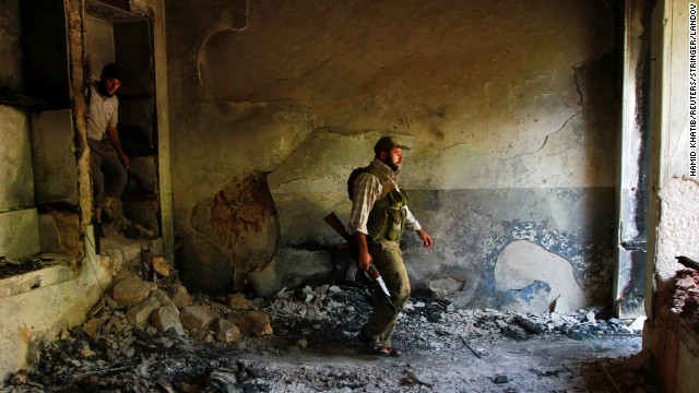 Image #: 24153686    Free Syrian Army fighters walk inside a damaged house near Hanano Barracks in Aleppo, September 3, 2013. REUTERS/Hamid Khatib (SYRIA - Tags: POLITICS CIVIL UNREST CONFLICT MILITARY)       REUTERS /STRINGER /LANDOV