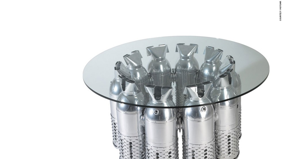 Magic Mike would love this MotoArt coffee table. It comes with a fancy name -- the F-4 Phantom -- and includes 10 burner cans with red LED internal illumination for mood lighting.