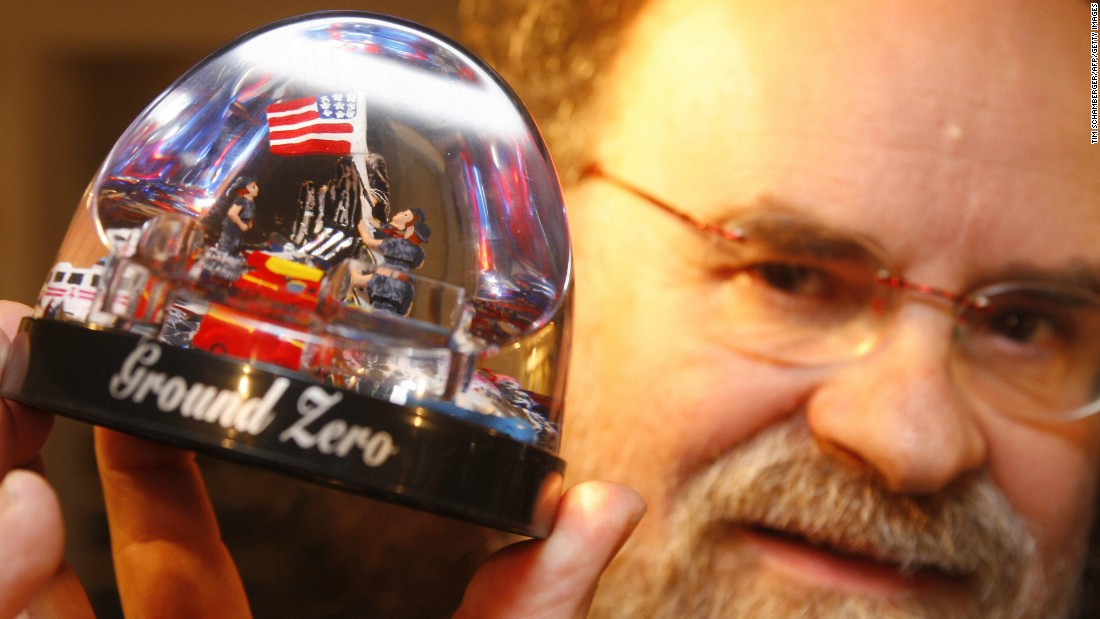 A snow globe owned by collector Josef Kardinal depicts the flag raising at ground zero. He is seen in 2006 at his home in Nuremberg, Germany.