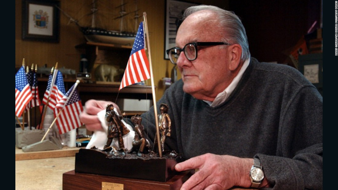 Artist Jim Conrad designed a sculptured bronze version of the flag raising in honor of the Rev. Mychal Judge, a New York Fire Department chaplain who lost his life while administering last rites on September 11, 2001. Conrad is seen polishing the sculpture in 2002 at his home in Lakewood, Colorado.
