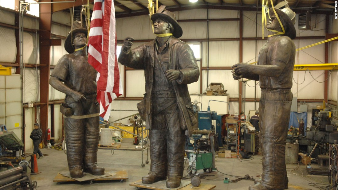 "A 40-foot-tall bronze monument named ""To Lift a Nation"" depicts the famous scene. Pictured at a warehouse in 2007, the sculpture is now part of the permanent collection at the National Fallen Firefighters Memorial Park in Emmitsburg, Maryland."