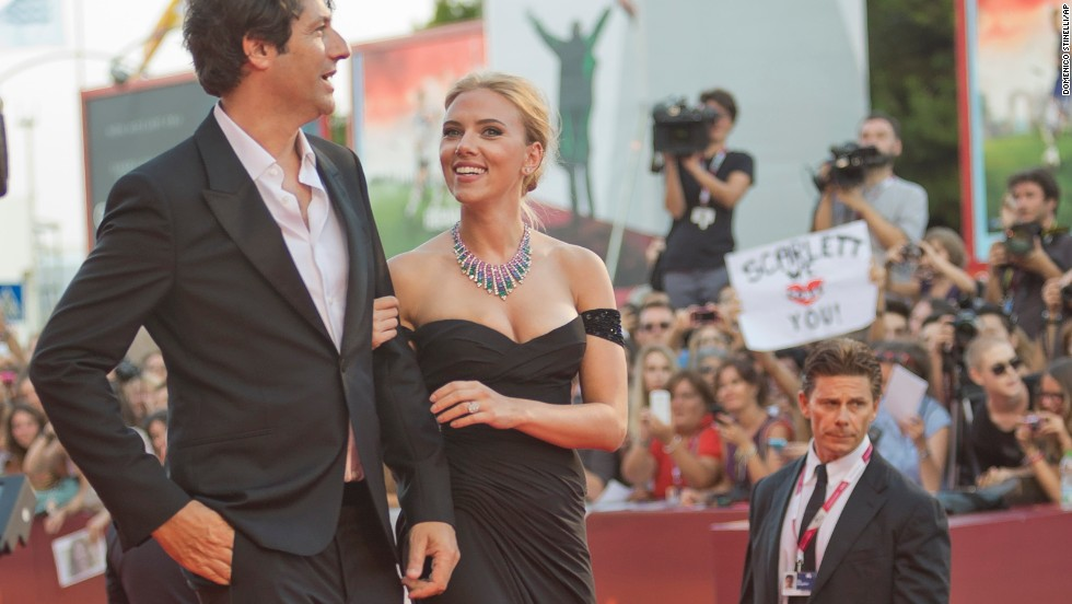 """Actress Scarlett Johansson, right, arrives with director Jonathan Glazer for the screening of the film """"Under the Skin"""" on September 3."""
