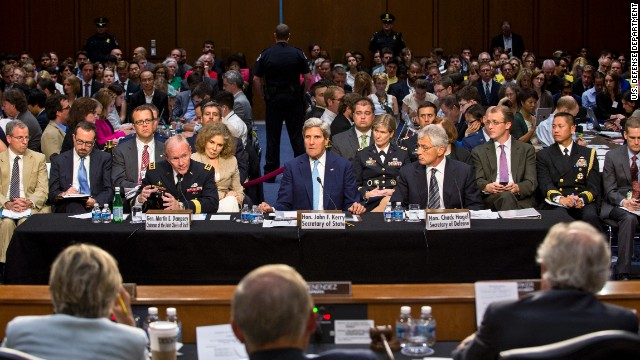 Army Gen. Martin Dempsey, chairman of the Joint Chiefs of Staff, left, Secretary of State John Kerry, center, and Defense Secretary Chuck Hagel testify on the potential use of U.S. military force in Syria during a hearing before the Senate Foreign Relations Committee in Washington, D.C., Sept. 3, 2013.