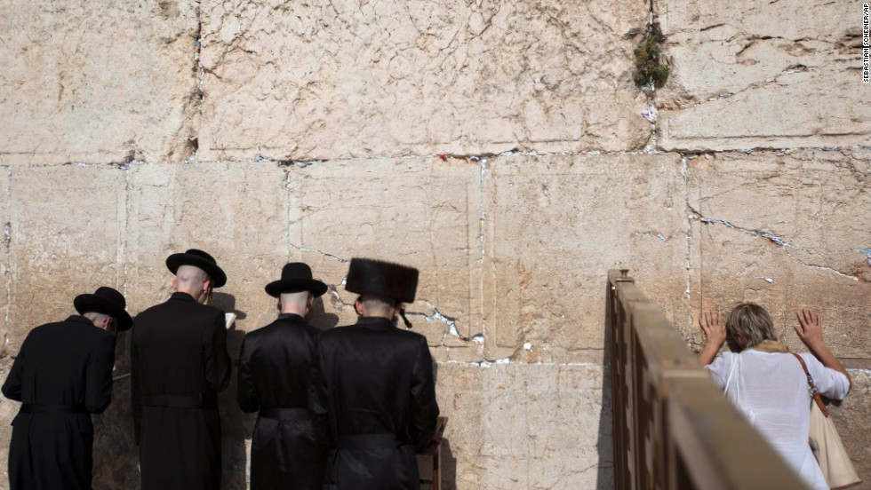Men and women pray on opposite sides of a separation fence at the Western Wall on September 4.