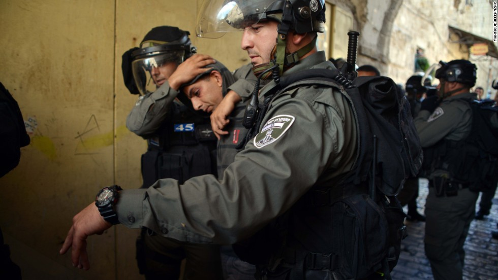 Israeli police officers detain a Palestinian man during clashes ahead of Rosh Hashanah in Jerusalem's Old City on September 4. Police said hundreds of demonstrators tried to block a group of visitors from reaching a hilltop compound known to Muslims as Noble Sanctuary and to Jews as Temple Mount. Some of the protesters were arrested after allegedly throwing stones at visitors.