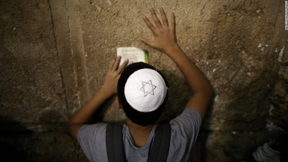 A young Jewish boy prays for forgiveness and mercy at the Western Wall on September 4.