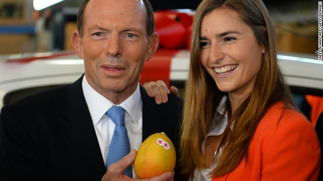 "Australian opposition leader Tony Abbott poses with a mango and one of his ""not bad looking daughters."" What will he say next?"