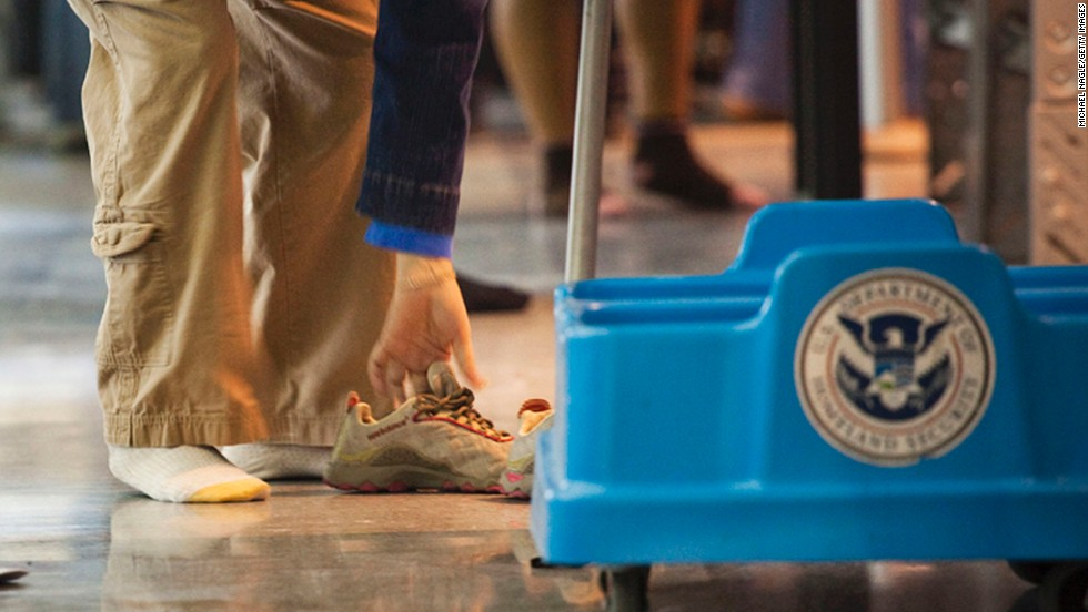 Airport security personnel are considered essential and will continue working through the shutdown. So if you fly, there will be someone there to ask you to remove your shoes.  (File photo)