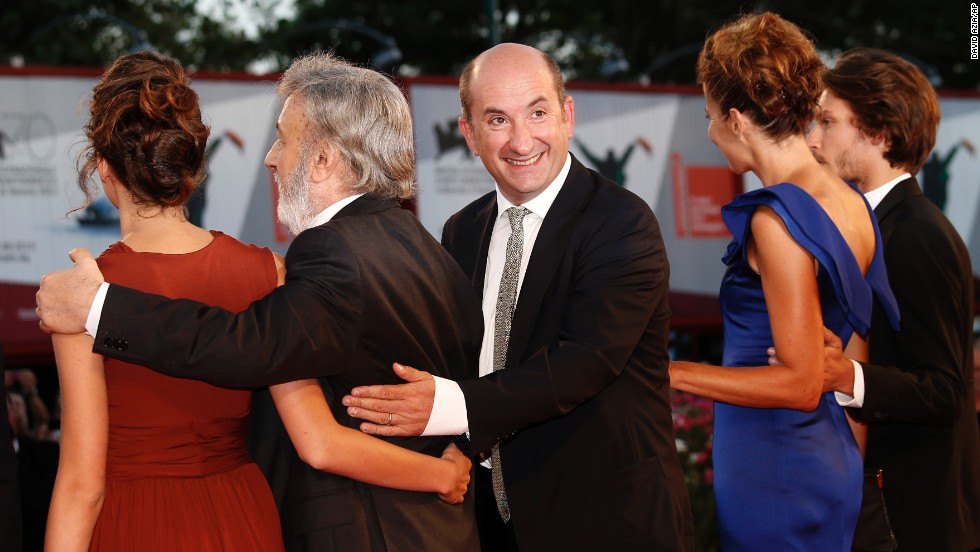 """Actor Antonio Albanese, center, poses for photos with fellow cast members from the film """"The Intrepid"""" on September 4."""