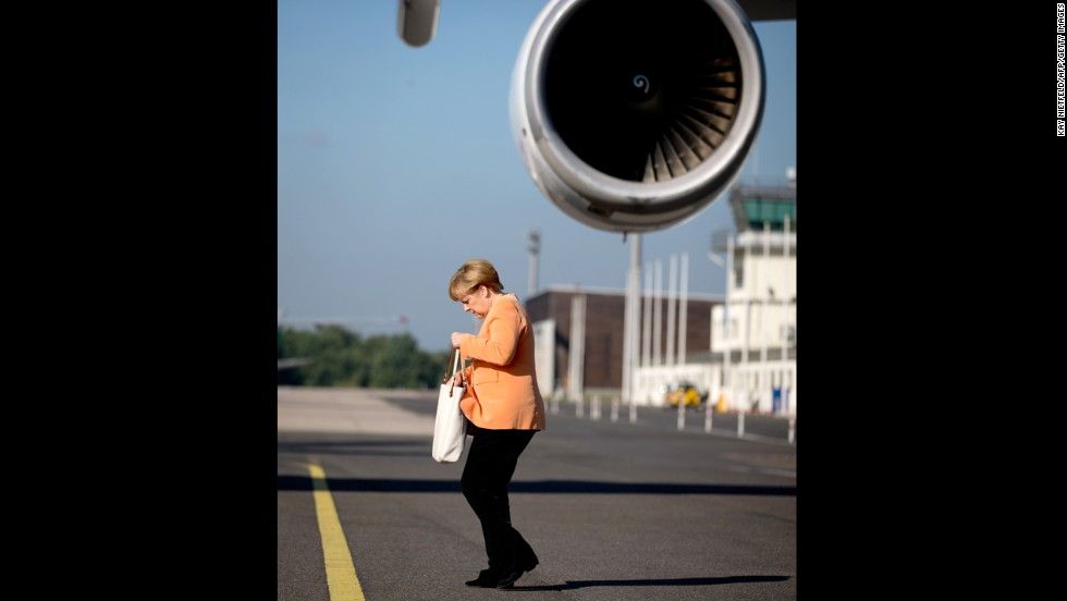 German Chancellor Angela Merkel arrives at the Tegel airport in Berlin on September 5 before heading to the G-20 summit in St. Petersburg.